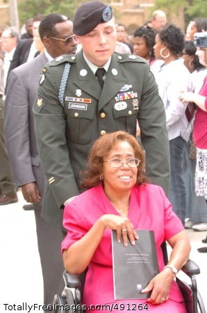 50th Anniversary Spec. James Johnson, from the 101st Airborne Division (Air Assault) escorts Little Rock Nine member Thelma Mothershed Wair to the newly dedicated Little Rock Central High School National Historic Site Visitor Center after the dedciation ceremony Sept. 24, 2007. Photo Credit: Sep 25, 2007