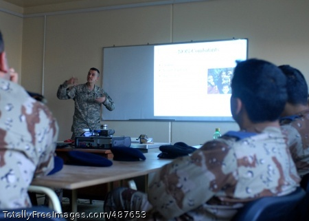 12th Combat Maj. James Teixeira, an attorney with the 12th Combat Aviation Brigade, explains principles of the law of armed conflict to a class of Iraqi air force cadets March 5 at Camp Taji, Iraq March 5. Photo Credit: Mar 10, 2008