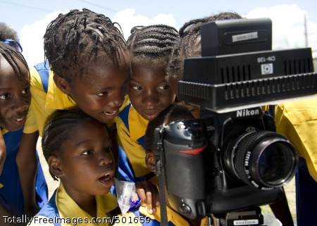 110419-N-RM525-454  KINGSTON, Jamaica (April 19, 2011) School children watch a video recording of themselves singing during a Continuing Promise 2011 community service project at Trenchtown Primary School in Kingston, Jamaica. Continuing Promise is a five-month humanitarian assistance mission to the Caribbean, Central and South America. (U.S. Navy photo by Mass Communication Specialist 2nd Class Jonathen E. Davis/Released)