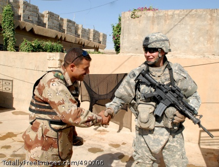 Forces Must Develop Capt. Steven Beard, from Military Transition Team, shakes hands with an Iraqi army officer during an Iraqi army cordon and search mission in  Photo Credit: Oct 5, 2007