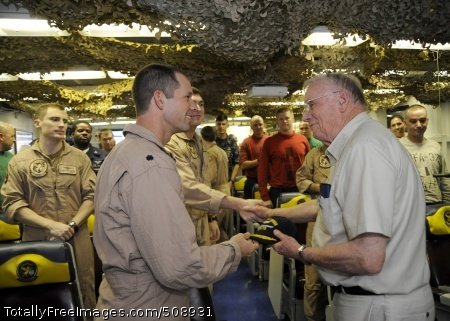101009-N-3705H-015 ARABIAN SEA (Oct. 9, 2010) Cmdr. Chad Vincelette, executive officer of the Swordsmen of Strike Fighter Squadron (VFA) 32, gives a Swordsmen ball cap to retired astronaut Neil Armstrong during the Legends of Aerospace tour aboard the aircraft carrier USS Harry S. Truman (CVN 75). The Harry S. Truman Carrier Strike Group is deployed in support of maritime security operations and theater security cooperation efforts in the U.S. 5th Fleet area of responsibility. (U.S. Navy photo by Mass Communication Specialist 3rd Class Nina Hughes/Released)