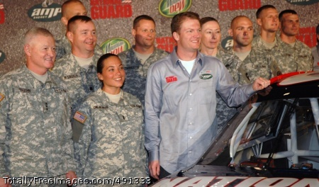 NASCAR's Dale Dale Earnhardt Jr., who will drive the National Guard car in 2008 in NASCAR's top-level Sprint Cup Series, stands tall among National Guard Soldiers in Dallas, Sept. 19. Lt. Gen. Clyde Vaughn (left), director of the Army National Guard, predicted that Mr. Earnhardt will attract more people to National Guard service.  Photo Credit: Sep 21, 2007