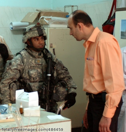 MND-B Troops Seek Maj. Amit Bhavsar talks with a doctor at a health clinic in the western Baghdad community of Adil on April 27. Bhavsar serves as the brigade surgeon for the 2nd Brigade Combat Team, 101st Airborne Division (Air Assault), Multi-National Division - Baghdad. He visited three hospitals in western Baghdad to assess their equipment shortfalls.  Photo Credit: Apr 30, 2008