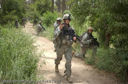 Jungle Patrol Paratroopers from 1st Platoon, Battery A, 2nd Battalion, 319th Airborne Field Artillery Regiment, 82nd Airborne Division, conduct a dismounted patrol through Al Suleikh, Iraq, June 20. Photo Credit: Jul 12, 2007
