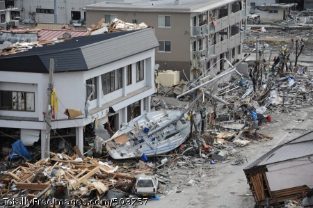 110315-N-2653B-118 OFUNATO, Japan (March 15, 2011) A fishing boat is among debris in Ofunato, Japan, following a 9.0 magnitude earthquake and subsequent tsunami. (U.S. Navy photo by Mass Communication Specialist 1st Class Matthew M. Bradley/Released)