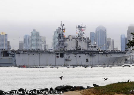 101218-N-8607R-026 SAN DIEGO (Dec. 18, 2010) The amphibious assault ship USS Peleliu (LHA 5) transits San Diego Harbor after a seven-month deployment. The Peleliu Amphibious Ready Group deployed to the U.S. 7th and U.S. 5th Fleet areas of responsibility conducting humanitarian relief in Pakistan and counter-piracy operations off the Horn of Africa. (U.S. Navy photo by Mass Communication Specialist 2nd Class Eva-Marie Ramsaran/Released)