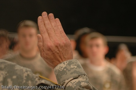 Soldiers get Brig. Gen. Daniel I. Schultz's hand is raised as he states the oath of enlistment and swears in 20 recruits March 2. Photo Credit: Mar 3, 2008