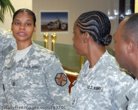New USAG-Red Cloud Command Sgt. Maj. Earlene Lavender (left) meets with Soldiers from HHC, USAG-Red Cloud, at Kilbourne Dining Facility following a company visit shortly after taking over as the command's senior Non-commissioned Officer.  Photo Credit: Jul 13, 2008