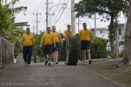 101212-N-5758H-014  MIYAKOJIMA, Japan (Dec. 12, 2010) Lt. Jeff Wrenn, left, Musician 3rd Class Charlie Perkes, Senior Chief Musician Adam Vincent, Musician 2nd Class Colin Reichow and Musician 3rd Class Benjamin Foss remove a tire from Painagama Beach on the island of Miyakojima during a beach cleanup community service project. The visit to Miyakojima was a first for the U.S. 7th Fleet Band and recognized the 50th anniversary of the signing of the U.S. and Japan Treaty of Mutual Cooperation and Security. (U.S. Navy photo by Mass Communication Specialist 2nd Class Kenneth R. Hendrix/Released)
