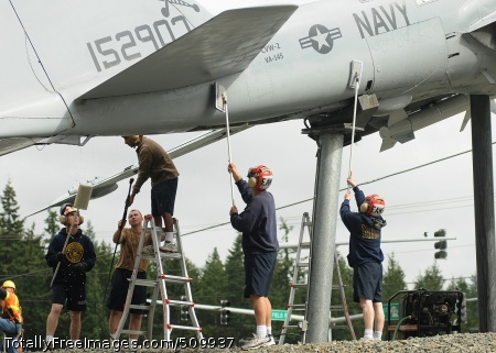 100910-N-9520G-012 OAK HARBOR, Wash. (Sept. 10, 2010) Chief petty officer selectees assigned to Naval Air Station Whidbey Island work together as they clean the display of the A-6 Intruder during the annual cleaning and inspection of the A-6 Intruder and EA-6B Prowler at the Navy Gateway Park at Naval Air Station Whidbey Island. (U.S. Navy photo by Mass Communication Specialist 2nd Class Nardel Gervacio/Released)