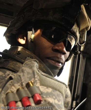 Faces of the Long Pfc. Brandon Stanfield awaits orders for his convoy to move out for a patrol of Riyahd village in Iraq March 8. Stanfield is with the 3rd Brigade Combat Team, 25th Infantry Division. Photo Credit: Mar 14, 2007