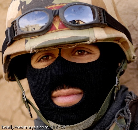 Faces in the Battle An Iraqi policeman assigned to the Emergency Services Unit provides security as a search of Qarah Cham village in Iraq is being conducted March 27. Photo Credit: May 2, 2007