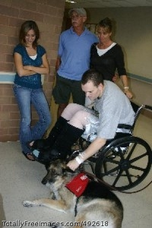 Man's Best Friend Army Pfc. James Oppelt spends some quality time with Jackson, a German shepherd therapy dog, at Brooke Army Medical Center while his fiancee, Andrea Preston, and parents, retired Marine Sgt. Patrick Oppelt and Sue Oppelt, look on.  Photo Credit: Jul 6, 2007