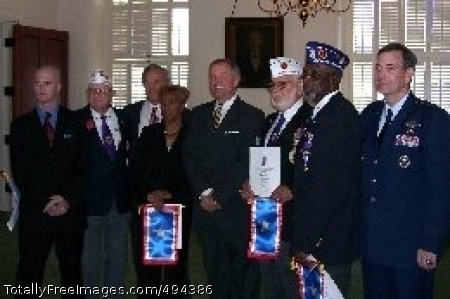 Alabama Declares Following Alabama Gov. Bob Riley's official declaration that his state will recognize May 1 as 'Silver Star Day,' state Rep. Greg Wren (fifth from left) held a reception for four veterans wounded in four different conflicts. Sean Phillips (from left), a veteran of the Iraq war; David Cox, a World War II veteran; Speaker Seth Hammett; Deloris Bryson, Leroy Arceneaux, a Korean War veteran; Robert Jones, a Vietnam veteran; and Air Force Lt. General Stephen Lorenz attended. Each veteran was presented a Silver Star Families of America banner in recognition of their sacrifices. Bryson, a Gold Star Mother, attended in honor of her son, Marine Gunnery Sgt. Stephen Bryson, who was killed in action. Photo Credit: Mar 20, 2007