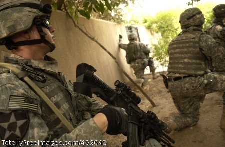 Operation Phantom Soldiers from 1st Battalion, 38th Infantry Regiment, 4th Stryker Brigade Combat Team, 2nd Infantry Division pull security outside of a house during a cordon and search in the Rashid district of Baghdad, June 20.  Photo Credit: Jul 5, 2007