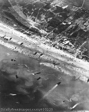 D-Day: Beach Traffic Army Air Corps photographers documented D-Day beach traffic, as photographed from a Ninth Air Force bomber on June 6, 1944. Note vehicle lanes leading away from the landing areas, and landing craft left aground by the tide. Photo Credit: May 31, 2007