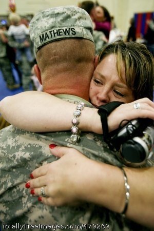 Units' return Heather Mathews embraces her husband, Spc. Grady Mathews, Nov. 7, 2008 during a return ceremony for Soldiers of the 514th Medical Company and 547th Medical Company from a 15-month deployment to Iraq. Photo Credit: Nov 14, 2008