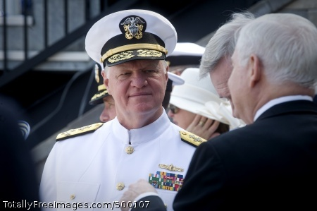 110527-N-ZB612-018 ANNAPOLIS, Md. (May 27, 2011) Chief of Naval Operations (CNO) Adm. Gary Roughead speaks with Secretary of Defense the Honorable Robert M. Gates during the Naval Academy Class of 2011 graduation and commissioning ceremony at Navy-Marine Corps Stadium. (U.S. Navy photo by Chief Mass Communication Specialist Tiffini Jones Vanderwyst/Released)