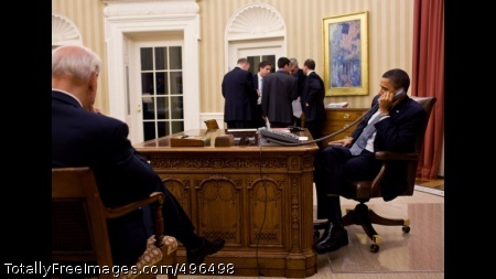 President Obama Talks on the Phone with President Hosni Mubarak of Egypt President Barack Obama talks on the phone with President Hosni Mubarak of Egypt in the Oval Office,  Jan. 28, 2011.  Vice President Joe Biden listens at left, and the President's National Security team confer in the background.  (Official White House Photo by Pete Souza)
