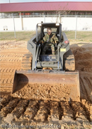101229-N-9564W-061 ROTA, Spain (Dec. 29, 2010) Equipment Operator Constructionman Apprentice Dylan Rowe, assigned to Alfa Company of Naval Mobile Construction Battalion (NMCB) 74, uses a skid steer to prepare the jobsite for a morale, welfare and recreation dog kennel project. NMCB-74 is deployed to Camp Mitchell at Naval Station Rota, Spain supporting Combined Task Force (CTF) 68. (U.S. Navy photo by Mass Communication Specialist 1st Class Ryan G. Wilber/Released)