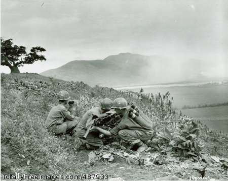 Korean War Korean Conflict - Sgt. Ron J. Gladstone of Battle Creek, MI (left); Cpl. John McCullough of Chicago, IL (center); and Pfc. John L. Robinson or Willard, KY, in position as they knocked out a machine gun nest of the Communist-led North Koreans with their 57-mm gun, somewhere in Korea.  This crew is credited with knocking out three machine gun nests. Photo Credit: Feb 26, 2008