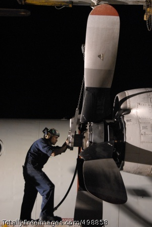 110620-N-WF583-067 SIGONELLA, Sicily (June 20, 2011) Aviation Machinist Mate 2nd Class Omar Viraclass, assigned to Patrol Squadron (VP) 45, installs a propeller on the number two engine of a P-3C Orion aircraft. VP-45 is deployed to Sigonella, Sicily supporting Operation Unified Protector. (U.S. Navy photo by Mass Communication Specialist 1st Class Michelle Lucht/Released)