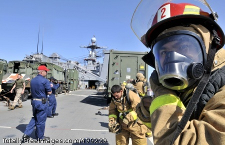110611-N-QP268-426 MEDITERRANEAN SEA (June 11, 2011) Boatswain's Mate Seaman Boyu Huang, from Brooklyn, N.Y., dons a self-contained breathing apparatus during the damage control Olympics aboard the amphibious dock landing ship USS Whidbey Island (LSD 41). Whidbey Island is deployed as part of the Bataan Amphibious Ready Group supporting maritime security operations and theater security cooperation efforts in the U.S. 6th Fleet area of responsibility. (U.S. Navy photo by Mass Communication Specialist 1st Class Martin Cuaron/Released)