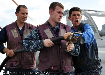 101112-N-3620B-009 SOUTH CHINA SEA (Nov. 12, 2010) Aviation Boatswain's Mate (Handling) Airman Serge Soucy, right, relieves Culinary Specialist 3rd Class Christopher Plowden as number one nozzleman during a flight deck fire drill aboard the amphibious transport dock ship USS Denver (LPD 9). Denver is part of the permanently forward-deployed Essex Amphibious Ready Group and is underway for a scheduled patrol in the western Pacific Ocean. (U.S. Navy photo by Mass Communication Specialist 3rd Class Bryan Blair/Released)