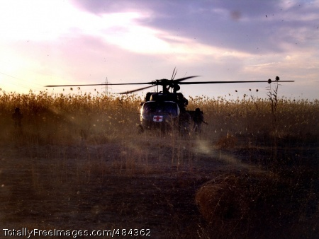 Iraq medevac A medevac flight sits in a field as seen through the windshield of the first aircraft during a mission to rescue Soldiers injured in an attack in Iraq.  Photo Credit: Jun 26, 2008