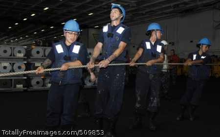 100914-N-1276B-024 PACIFIC OCEAN (Sept. 14, 2010) Sailors assigned to deck department aboard the aircraft carrier USS Nimitz (CVN 68) pull in a messenger line from the Military Sealift Command dry cargo and ammunition ship USNS Wally Schirra (T-AKE 8) during an ammunition offload. Nimitz is conducting blue water operations in the U.S. 3rd Fleet area of responsibility. (U.S. Navy photo by Mass Communication Specialist 2nd Class Orrin Batiste/Released)