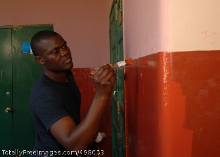 110625-N-ZI300-169 VALPARAISO, Chile (June 25, 2011) Seaman Francis Mliswa, assigned to the guided-missile frigate USS Boone (FFG 28), paints a hallway during a community service event at the Escuela Juan de Saavedra during the Chilean-hosted Pacific phase of UNITAS 52. UNITAS is a multinational exercise as part of Southern Seas 2011. (U.S. Navy photo by Mass Communication Specialist 1st Class Steve Smith/Released)
