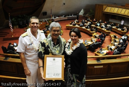 110204-N-WP746-069 HONOLULU (Feb. 4, 2011) Stanford Yuen, center, the inter-governmental affairs executive assistant for Commander, Navy Region Hawaii, receives a plaque of recognition from the Hawaii House of Representatives at the Hawaii State Capitol. Rear Adm. Dixon Smith, left, commander of Navy Region Hawaii, and his wife, accompanied Yuen. (U.S. Navy photo by Mass Communication Specialist 2nd Class Mark Logico/Released)