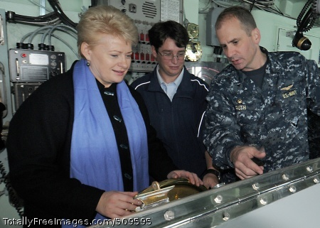 100921-N-0982V-019 BALTIC SEA (Sept. 21, 2010) President of Lithuania Dalia Grybauskaite, left, operates the helm of the amphibious command ship USS Mount Whitney (LCC/JCC 20) as commanding officer Capt. Jeffrey Ruth explains how it maneuvers the ship. Grybauskaite toured the ship during exercise Jackal Stone 2010. Mount Whitney is operating in the Baltic region supporting Jackal Stone, a 10-day special operations exercise with participation from Croatia, Latvia, Lithuania, Poland, Romania, Ukraine and the United States. (U.S. Navy photo by Mass Communication Specialist 1st Class Terry Vick/Released)