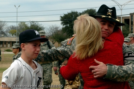 Traverse City, Mich., native Col. Daniel Shanahan, the 1st Air Cavalry Brigade commander, hugs his wife, Mindy, and reaches out for his oldest son, Patrick during the homecoming ceremony held Dec. 21 at 1st Cavalry Division headquarters. Shanahan was one of more than 200 Soldiers in the ceremony who just returned from Iraq.  Photo Credit: Dec 27, 2007