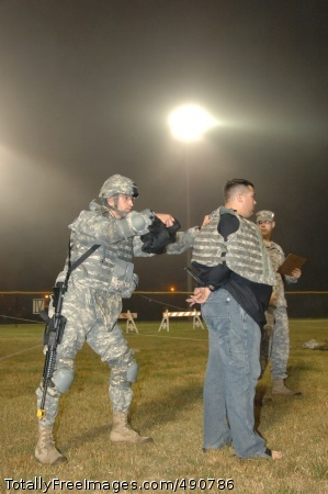 Taking Charge Competitor Cpl. Mihai Mocanu conducts detainee operations during the 2007 Department of the Army Noncommissioned Officer/Soldier of the Year Competition Oct. 4 at Fort Lee, Va.  Photo Credit: Oct 4, 2007