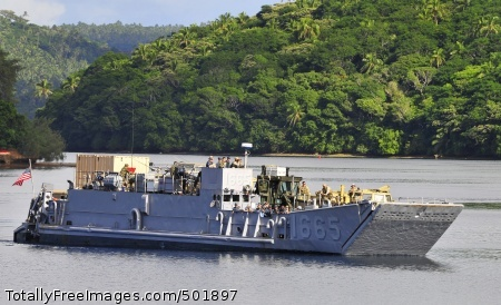 110413-N-KB563-120 VAVA'U, Tonga (April 13, 2011) A landing craft utility (LCU) from the amphibious transport dock ship USS Cleveland (LPD 7) pulls into the main wharf during Pacific Partnership 2011. Pacific Partnership is a five-month humanitarian assistance initiative that will make port visits to Tonga, Vanuatu, Papua New Guinea, Timor-Leste, and the Federated States of Micronesia. (U.S. Navy photo by Mass Communication Specialist 2nd Class Michael Russell/Released)