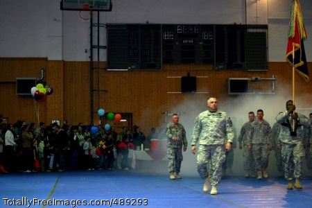 Commander of U.S. Col. J.B. Burton, commander of U.S. Army Europe's 2nd 'Dagger' Brigade Combat Team, 1st Infantry Division, leads his Soldiers into Schweinfurt, Germany's Finney Fitness Center for their welcome home ceremony Nov. 20, marking an end to the unit's 15-month deployment in Iraq. Photo Credit: Dec 5, 2007