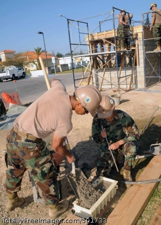 110412-N-AW868-088  ROTA, Spain (April 12, 2011) Engineering Aid Constructionman Jonathanjan Samson, left, and Engineering Aid 3rd Class Ke Xu, both assigned to Naval Mobile Construction Battalion (NMCB) 74 Headquarters Company, fill a concrete beam with fresh concrete during a bus stop project. NMCB-74 is deployed to Camp Mitchell on Naval Station Rota supporting Commander Task Force (CTF) 68. (U.S. Navy photo by Mass Communication Specialist 1st Class Ryan G. Wilber/Released)