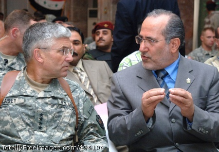 Army to Welcome New Gen. Casey speaks with Iraqi National Security Advisor Mowaffak al-Rubaie at Forward Operating Base Dagger in Tikrit, Aug. 8, 2006. Photo Credit: Apr 11, 2007
