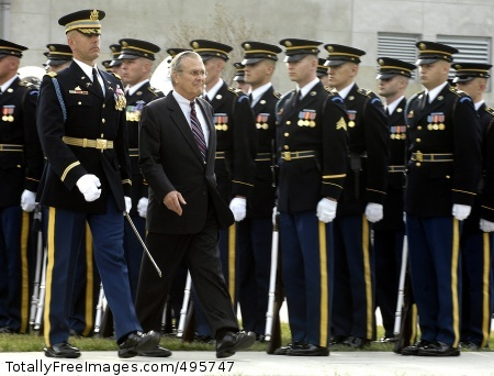 Soldiers honor Secretary of Defense Donald H. Rumsfeld reviews the troops.  Photo Credit: Dec 19, 2006