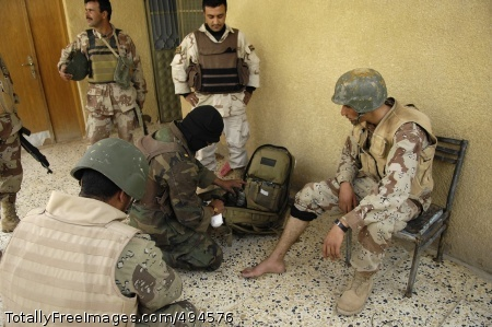 Securing Tahrir An Iraqi medic treats an Iraqi Soldier who was shot in the toe. Photo Credit: Mar 9, 2007