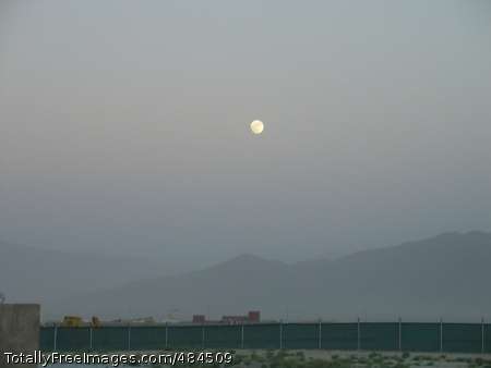 Afghan moonrise An early evening moon rises above mist-shrouded mountains east of Bagram Airfield, Afghanistan, June 17, 2008.  Photo Credit: Jun 22, 2008
