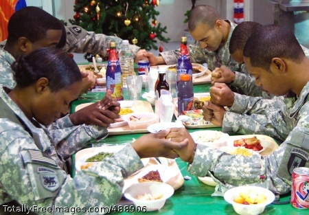 Giving Thanks Soldiers from the U.S. Army Corps of Engineers in Baghdad say Grace before their holiday meal. Photo Credit: Dec 26, 2007