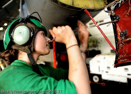 101003-N-6427M-079 ARABIAN SEA (Oct. 3, 2010) Aviation Electronics Technician 2nd Class Mandie Ellis, from Burrillville, R.I., assigned to Electronic Attack Squadron (VAQ) 130, removes a worn out shock mount on a EA-6B Prowler during preventive maintenance aboard the aircraft carrier USS Harry S. Truman (CVN 75). VAQ-130 is deployed as part of the Harry S. Truman Carrier Strike Group supporting maritime security operations and theater security cooperation efforts in the U.S. 5th Fleet area of responsibility. (U.S. Navy photo by Mass Communication Specialist Seaman Ryan McLearnon/Released)