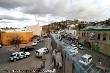Beefing Up the The towns of Nogales, Ariz., left, and Nogales, Mexico, stand separated by a high concrete and steel fence. Many consider the area one of the most dangerous along the border, with numerous reports from U.S. Border Patrol agents of being spit on, having rocks thrown at them and gunfire. Despite the existence of a legal crossing point, enough illegal crossings occur to warrant 24-hour Border Patrol operations there.  Photo Credit: Jan 30, 2007