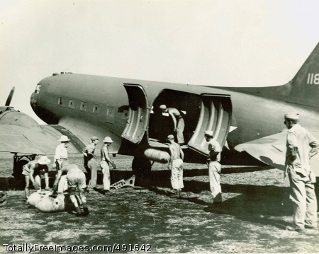What goes in, must Soldiers and airmen unload a C-47 cargo plane in New Guinea. Photo Credit: Sep 9, 2007