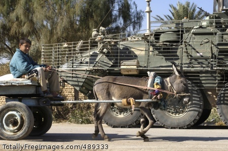 Old Technology An Iraqi child drives a donkey cart past a 2nd Infantry Division Stryker vehicle in Baqubah. While the Stryker is relatively new technology, the donkey cart has been in use in Iraq for thousands of years. Photo Credit: Dec 4, 2007