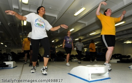 110621-N-QL471-152 GULF OF ADEN (June 21, 2011) Aviation Maintenance Administrationman 1st Class Brandi Heath, left, and Aviation Ordnanceman 2nd Class Tonia Devine participate in a Zumba class in the foc'sle aboard the aircraft carrier USS George H.W. Bush (CVN 77). George H.W. Bush is deployed supporting maritime security operations and theater security cooperation efforts in the U.S. 5th Fleet area of responsibility on its first overseas deployment. (U.S. Navy photo by Mass Communication Specialist 3rd Class Billy Ho/Released)