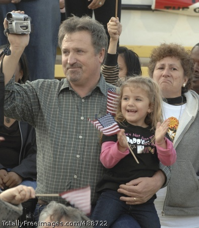 Anticipation Paul Lacure and his granddaughter, Kiersty, await the arrival of her dad, Jerrett Lacure, during a welcome-home ceremony at Fort Hood, Texas.  Lacure is a member of the 1st Air Cavalry Brigade, returning from a 15-month deployment to Iraq. Photo Credit: Jan 6, 2008