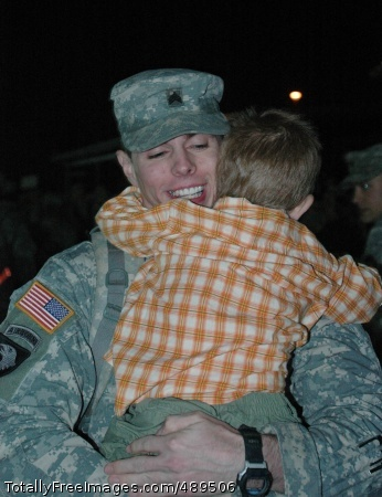 Lawrenceburg, Ky, native Sgt. Russell Neal, an apache mechanic with 4th Battalion, 227th Aviation Regiment, 1st Air Cavalry Brigade, 1st Cavalry Division, shares a hug with his 3-year-old son, Isaiah, at a homecoming ceremony on Cooper Field at Fort Hood, Texas, during the early morning hours Nov. 21. Photo Credit: Nov 27, 2007